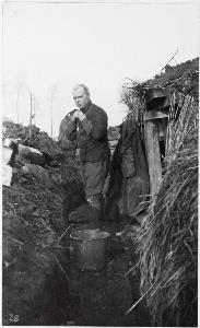 Major Graham Chaplin dressing in trenches outside Armentieres, 1915 (photo by Fred Davidson)