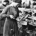 Press photograph of a women undertaking skilled work during WW1
